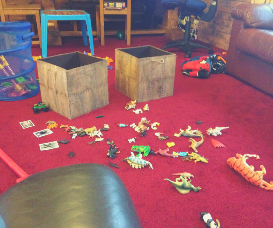 A mess of toys on a red carpet in a lounge - a great opportunity to teach your children about work.