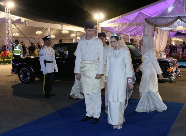 Dutchman Dennis Muhammad and Johor Princess Tunku Tun Aminah Maimunah Iskandariah Sultan Ibrahim, after wedding ceremony at the Istana Besar