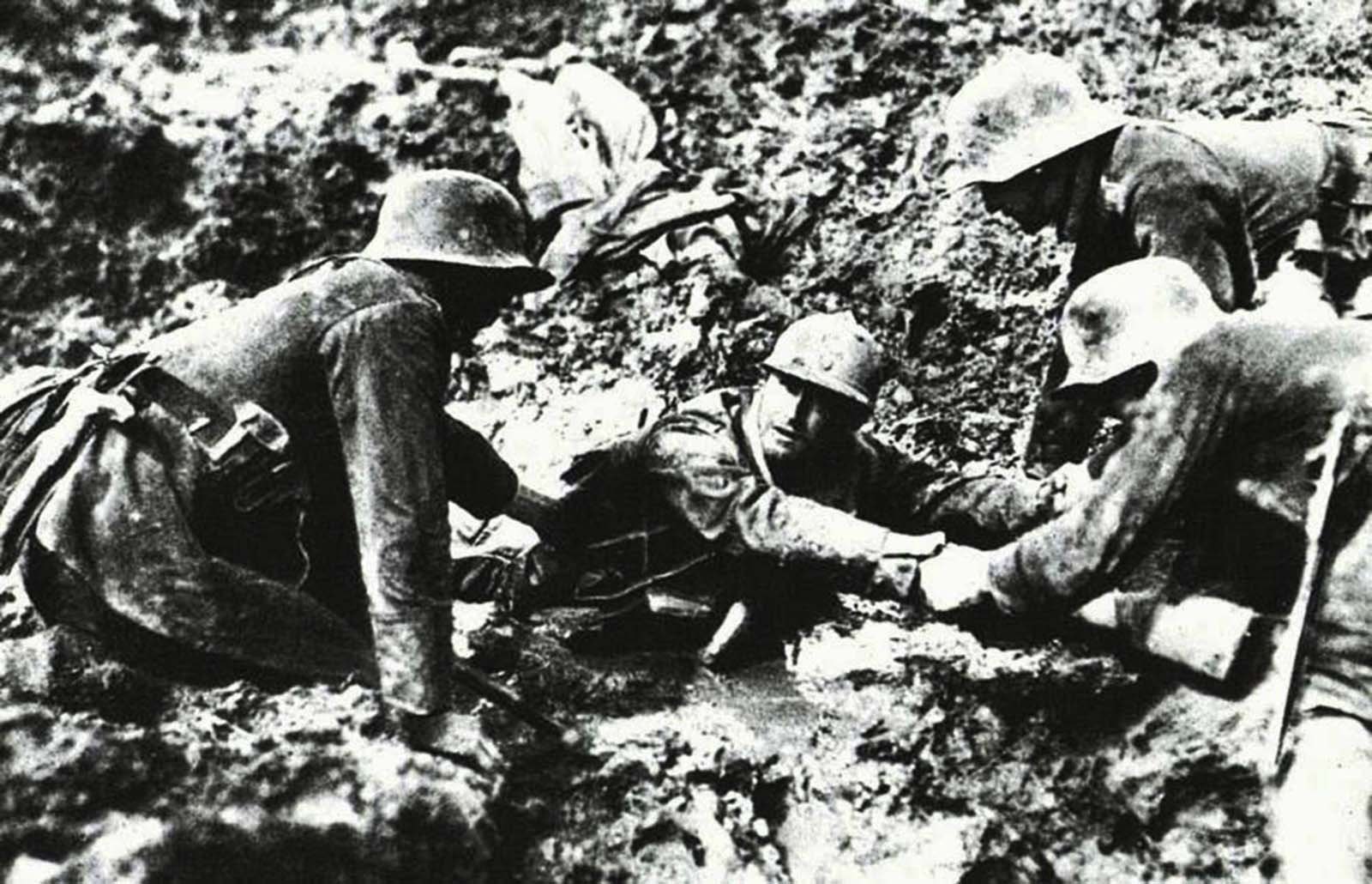 Germans helping a French wounded soldier, 1916.