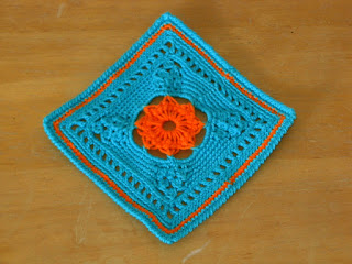 Rosette Square Coaster - One of A Set of 4 - in Turquoise and Orange By Ruth Sandra Sperling - RSS Designs In Fiber