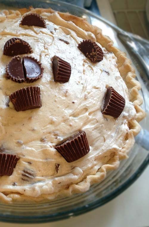 No Bake Reeses Cup Peanut Butter Pie ~ It's as easy as whipping up peanut butter with cream cheese and whipping cream. Mix in some Mini Reeses Cups. Refrigerate. And serve.