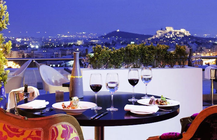 The World's 30 Best Rooftop Bars… Everyone Should Drink At #9 At Least Once. - The Galaxy Restaurant & Bar at Hilton in Athens, Greece is considered one of the best rooftop bars in the world.