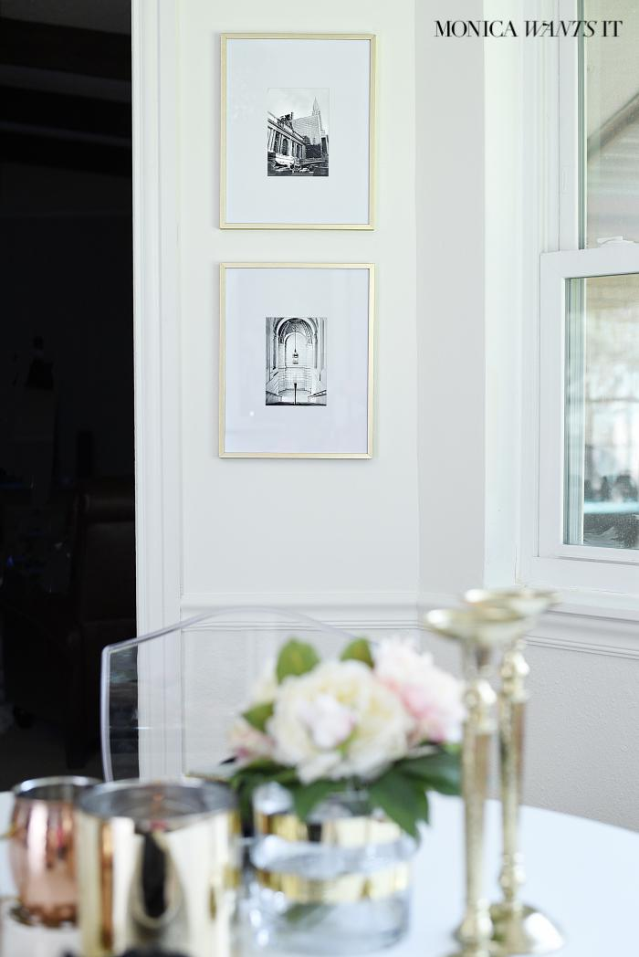 Breakfast nook makeover with hints of coral, pink, gold and black and white.
