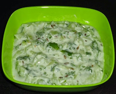 cucumber raita in a serving bowl