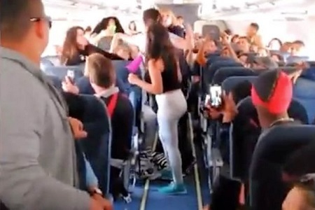 Female Air Passengers Caught on Camera Exchanging Vicious Blows While Plane Was Still in Mid-air (Video)
