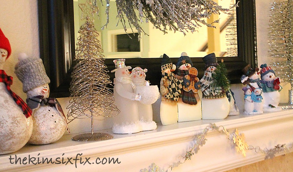 ... holiday decorations, I put all my little snowman figurines in a big  grouping on the table and I just couldn't wrap them in paper and tuck them  away.. ...