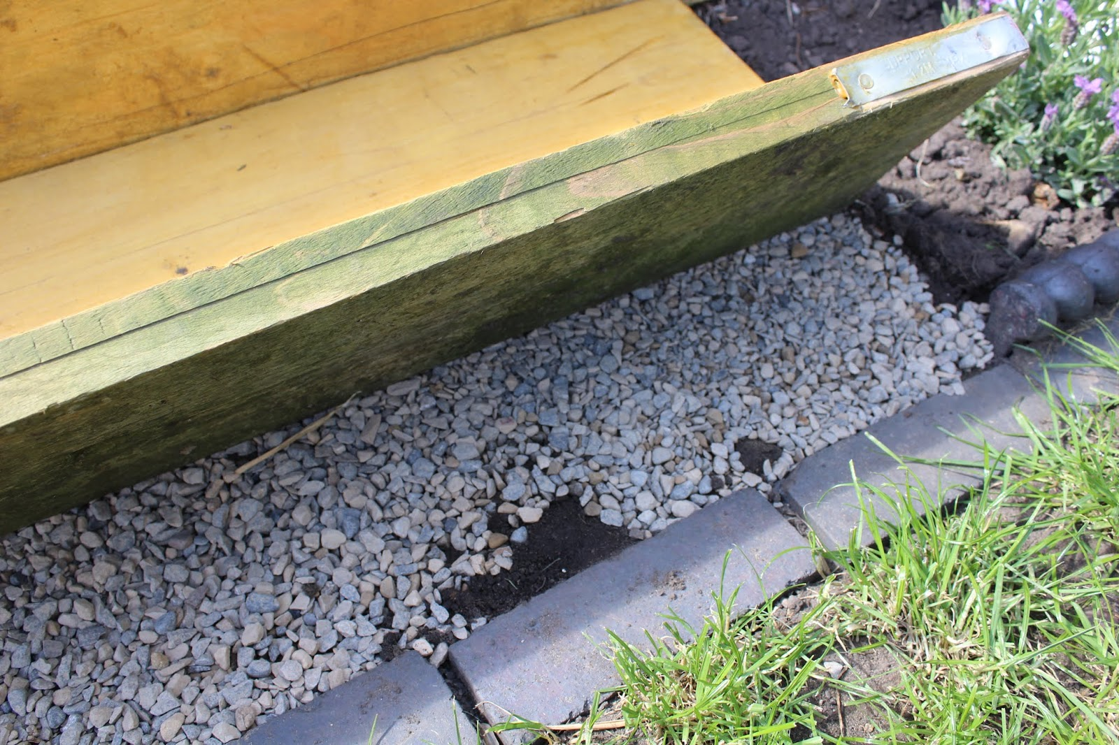 Step laid on top of gravel in garden