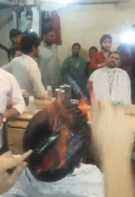 Meet the Indian barber who cuts men's hair by setting it on fire (photos)