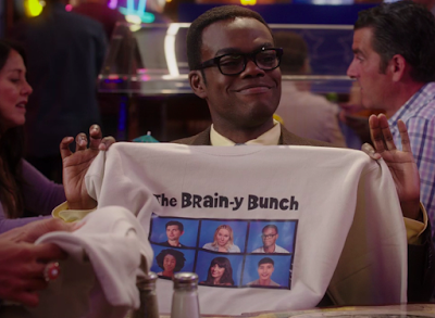 "Chidi holds a tan sweatshirt that says ""The Brain-y Bunch."" Below that, there's a 3x2 grid with pictures of (top row) Trevor, Eleanor, Chidi, (bottom row) Simone, Tahani, Jason"