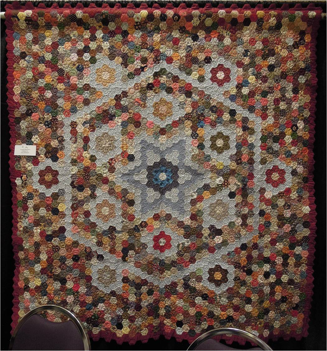 2ba15a432 Imagine the work that went into this intricate pattern, done in rich autumn  colors of russet, olive green, and burgundy. We love the look of all-hexagon  ...