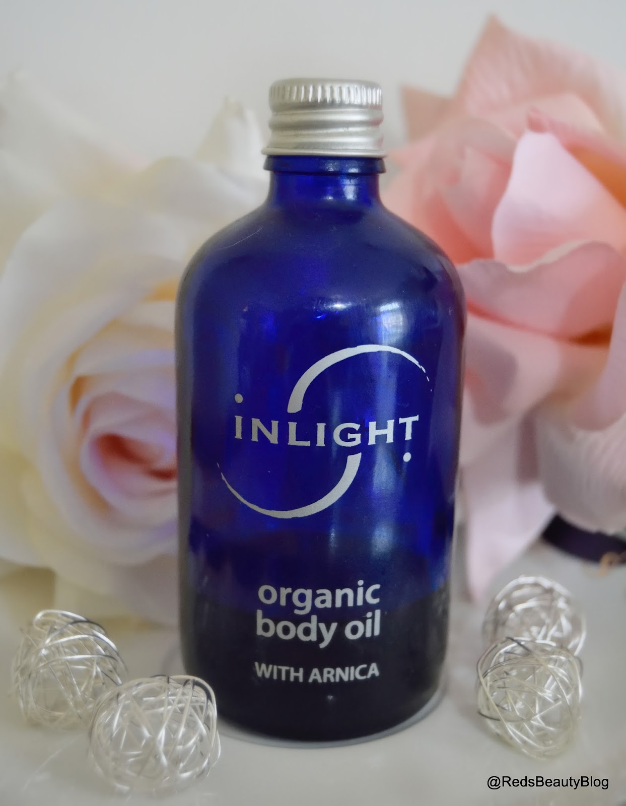 a picture of Inlight body oil with arnica