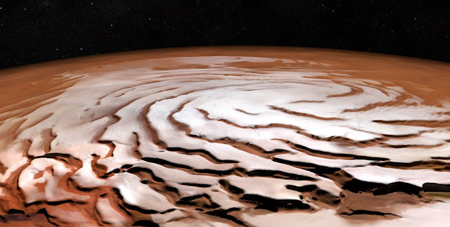 Perspective view of the Mars north polar ice cap and its distinctive dark troughs forming a spiral-like pattern. The view is based on images taken by ESA's Mars Express and generated using elevation data from the Mars Orbiter Laser Altimeter (MOLA) on board the NASA Mars Global Surveyor mission. Credit: ESA/DLR/FU Berlin; NASA MGS MOLA Science Team