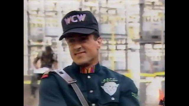Sylvester Stallone wearing a WCW hat on the movie set of Demolition Man