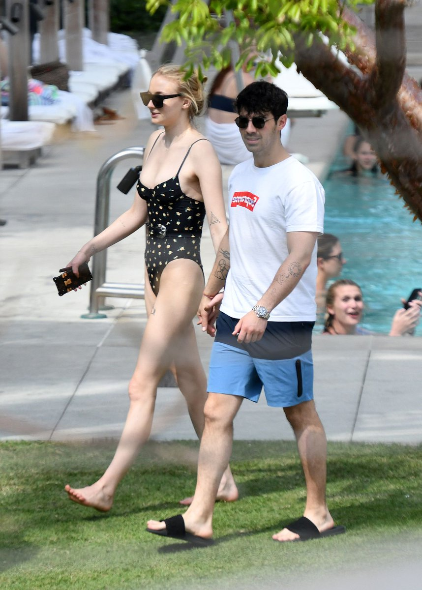 Sophie Turner shows off her impressive figure in low-cut bathing suit as she enjoys Miami with fiance Joe Jonas