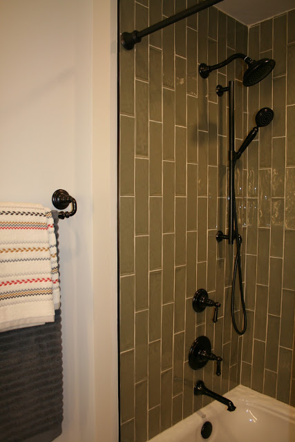 Dark vertical subway tile in guest bath of cottage farmhouse in Palmetto Bluff, SC | The Lowcountry Lady
