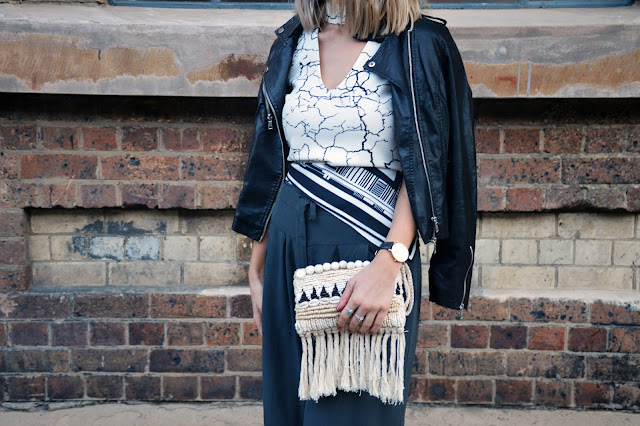 draped leather jacket as cape fashion week street style