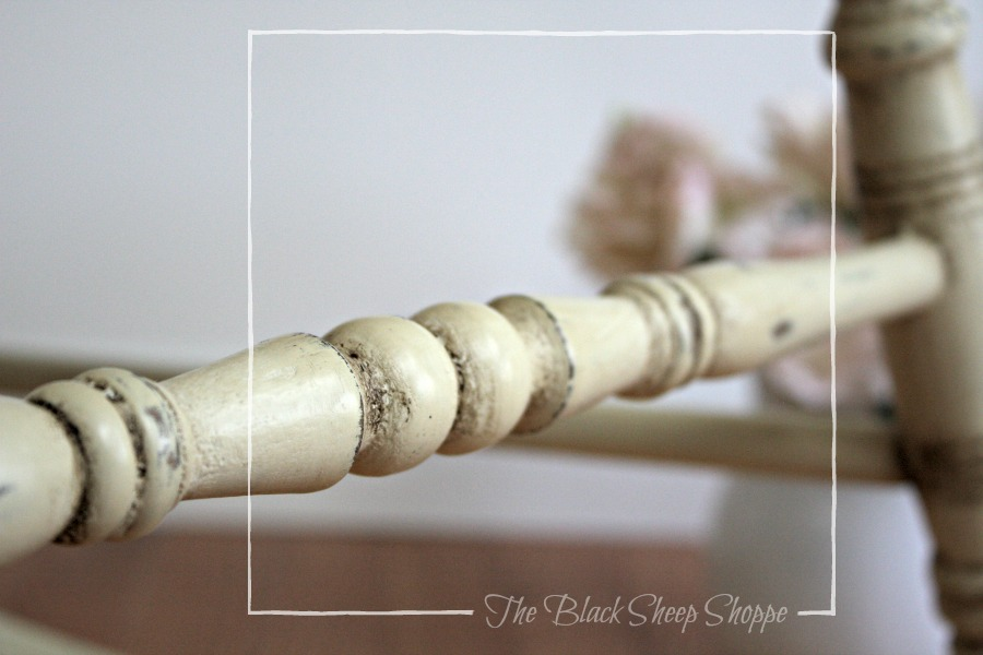 Bottom spindle cross support on rocking chair painted in Cream Chalk Paint.