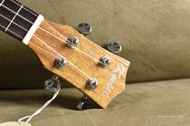 Kmise Carved Cat Concert Ukulele headstock