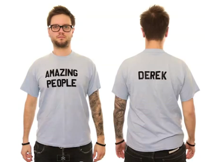 Derek Brooks modeling one of his many T-shirts
