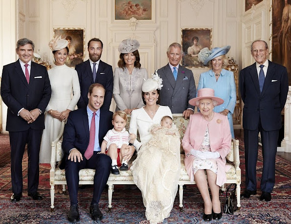 Prince William, Prince George, and the Duchess of Cambridge, holding the little princess. Standing, from left: Michael Middleton, Pippa Middleton, James Middleton, Carole Middleton, The Prince of Wales, The Duchess of Cornwall and The Duke of Edinburgh.