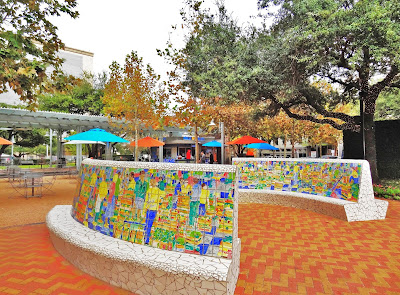 Artful mosaic stone benches at old Market Square - Downtown Houston Historic District