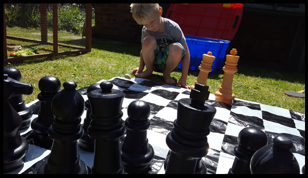 Learning to play chess in the sunshine - a great way to get your kids outdoors, exercise their brain and make memories