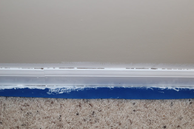 How to paint trim white: Paint your wood baseboards like a pro without sanding with these step-by-step tips, regardless of if you have hardwood, tile, or carpet. These steps can also be used to paint wood window trim. This project may seem daunting, but you won't believe what a difference this will make in your home. Click this post for a full list of steps and materials.