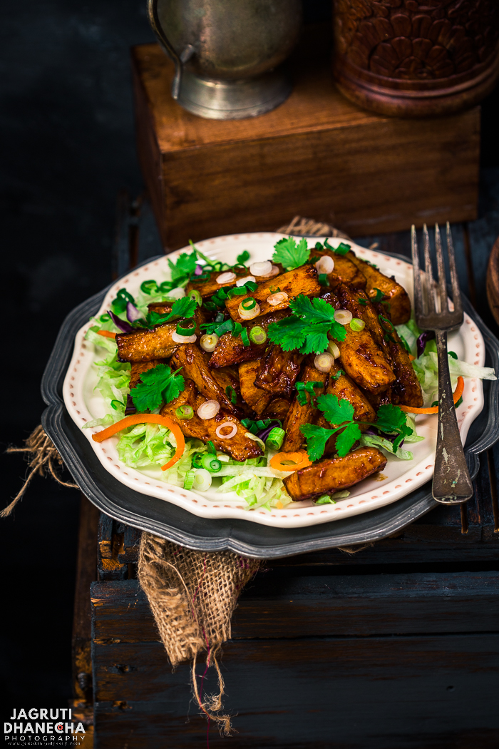 Masala Mogo/Cassava is a lip-smacking and sensational starter or a snack. Deep fried mogo/cassava in a sweet, spicy garlicky sauce, excellent with chilled drinks. This is a straightforward recipe and packs a serious flavour punch. Making this meal couldn't be easier!