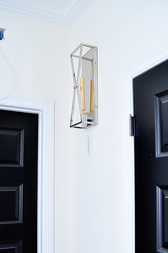 Capital Lighting Fire & Ice Sconce: Our lighting choices for our new home. Learn how we saved $1000. | via monicawantsit.com