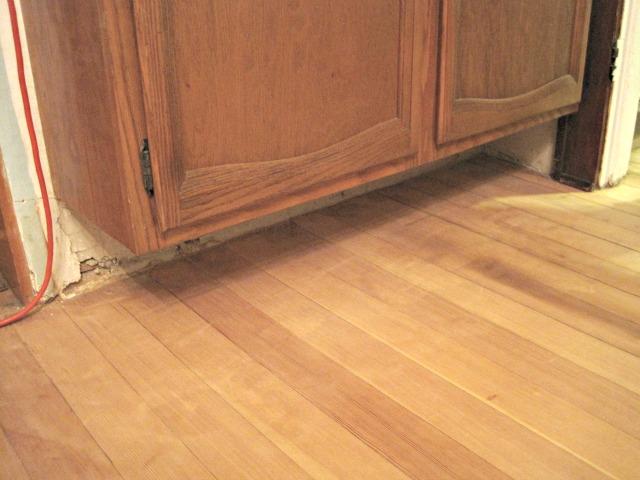 hardwood floor under cabinet