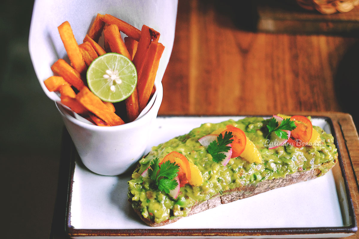 toasted baguette with generous guacamole spread on top and with sweet yam fries on the side (www.culinarybonanza.com)