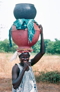 Woman carrying water in Mali Africa 1983