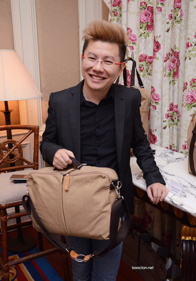 The ever fashionable Xavier Mah showcasing one of the bags from QWSTION