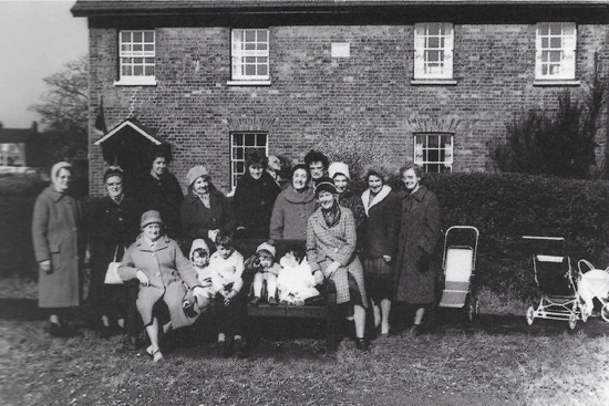 Photograph of Group of villagers who attended the North Mymms Womens' Institute planting ceremony at the triangle, Welham Green, March 29, 1966
