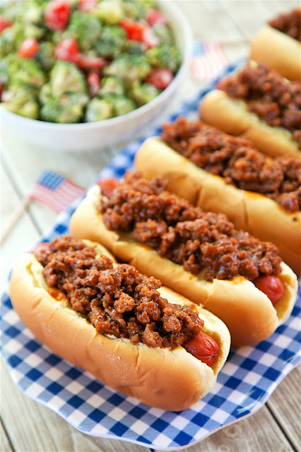 BBQ Beef Hot Dogs - only 4 ingredients! Hamburger, BBQ sauce, hot dogs and buns. SO easy and SO delicious! Top with cheese and fried onions if desired. The whole family loved these. Great for cookouts and tailgates!