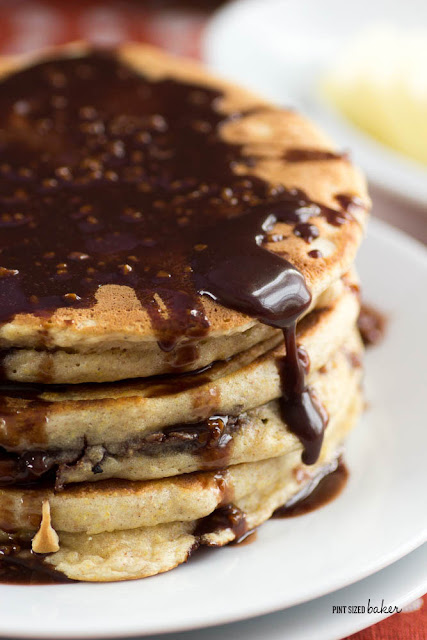 Chocolate stuffed pancakes with melted chocolate drizzled over top. Totally decadent and totally worth it!