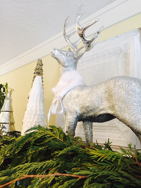 Silver deer on shelf, Christmas decor