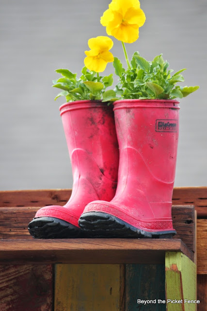 use rain boots from a thrift store for a planter