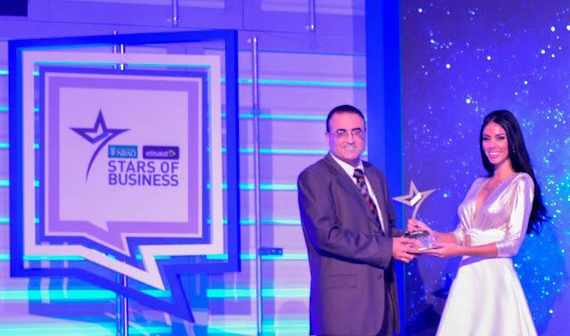 Nidal Abou Zaki, MD, Orient Planet Group receiving the recognition award under the media category