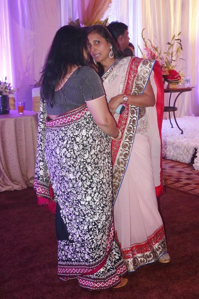 Women in sari gossiping