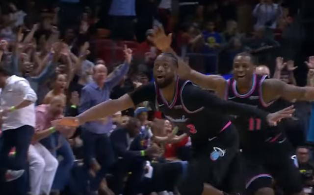 Dwyane Wade celebrates his buzzer beater over Golden State