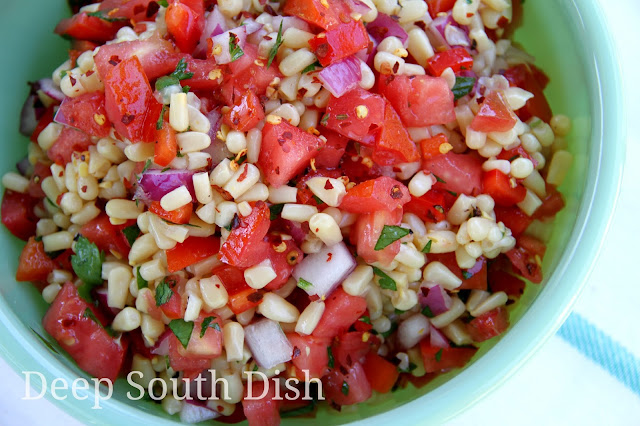 Garden fresh corn, sweet bell peppers, tomatoes and some red onion, combine with a sweet and sour vinegar and oil dressing for a wonderful summer salad!