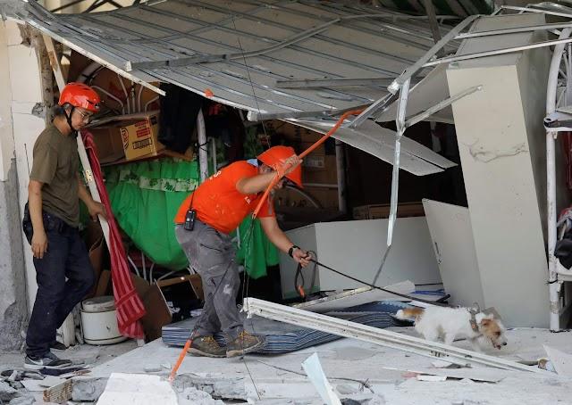 Earthquake hit four-story building, killing 8 Filipinos