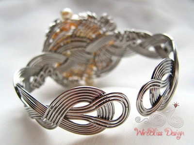bottom view of braided wire wrapped cuff with pearls