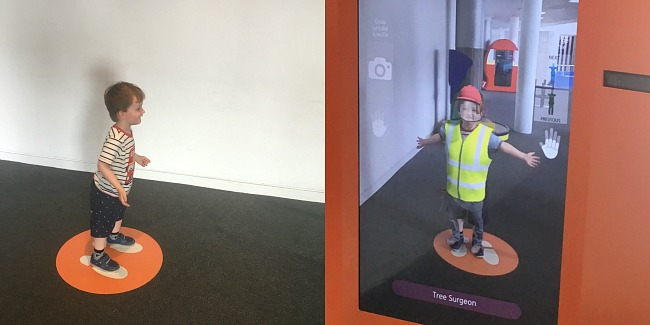 Techniquest-Virtual-Reality-changing-room-a-toddler-explores-collage-of-toddler-and-image-of-toddler-in-tree-surgeon-uniform