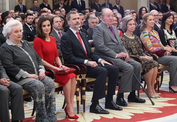 Queen Letizia wore Carolina Herrera red peplum stretch wool dress and Carolina Herrera clutch. Queen Sofia and Infanta Elena