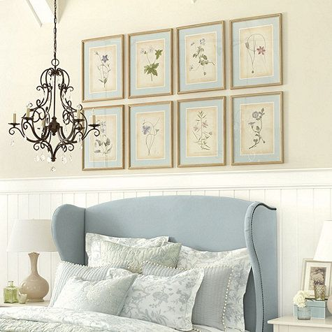 botanicals grouping gallery wall light blue over bed