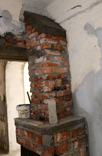 The chimney, including cement cap