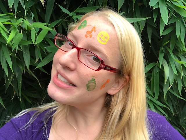Me looking beautiful with Snazaroo Birthday Party face paint stamps on my face (a cake, music notes and a smiley face)