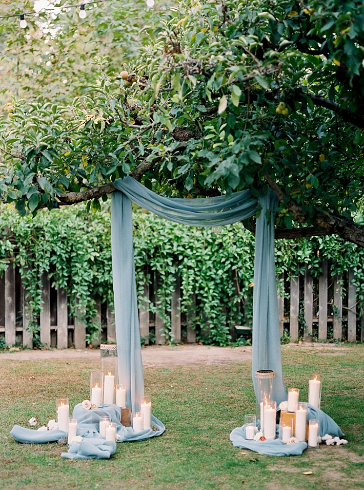 Ceremony drapery with candles | Photo by Dennis Roy Coronel | See more on thesocalbride.com